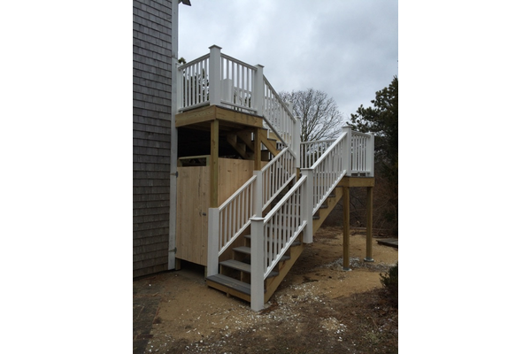 Outdoor shower and stairs<br>leading to second floor deck