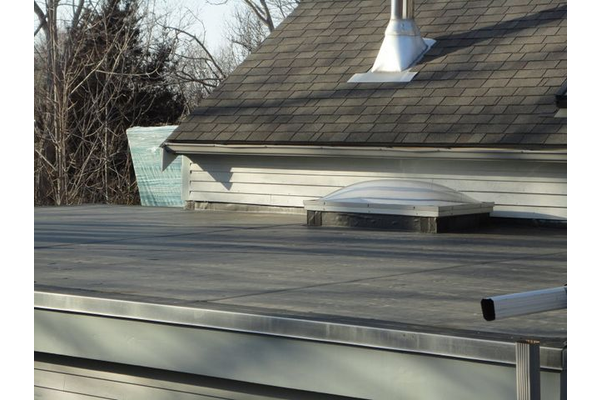 Flat EPDM roof and re-flashed skylight